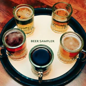 Beer sampler tray with 5 different types of beer in glasses